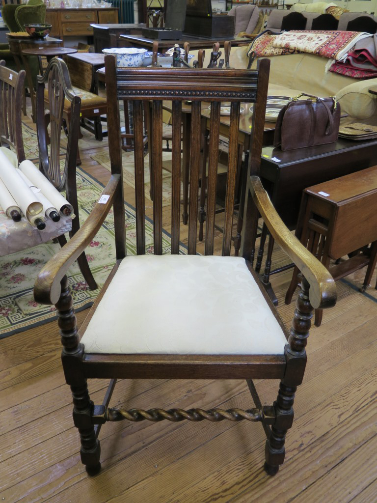 Lot 53 - An oak carver dining chair, with railback and turned and block legs