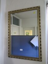 Lot 4 - An oak framed bevelled oval wall mirror 74cm x 50cm, two other giltwood framed rectangular wall