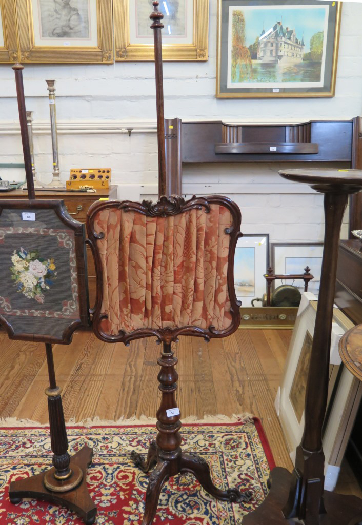 Lot 59 - An early Victorian rosewood pole screen, the foliate carved screen on a baluster turned stem and