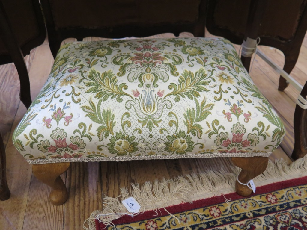 Lot 41 - A walnut footstool with floral overstuffed upholstery and cabriole legs, 51cm x 40cm