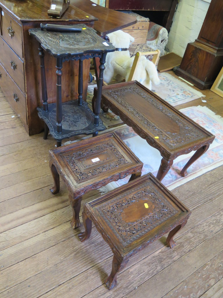 Lot 60 - A nest of three Indian softwood carved coffee tables, with pierced foliate carving, largest 76cm