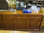 Lot 12 - A Bevan Funnell Reprodux crossbanded yew-wood side cabinet, with three short drawers and three
