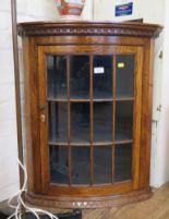 Lot 15 - An oak hanging corner cupboard, with dentil cornice and glazed door, 61.5cm wide, 75cm high