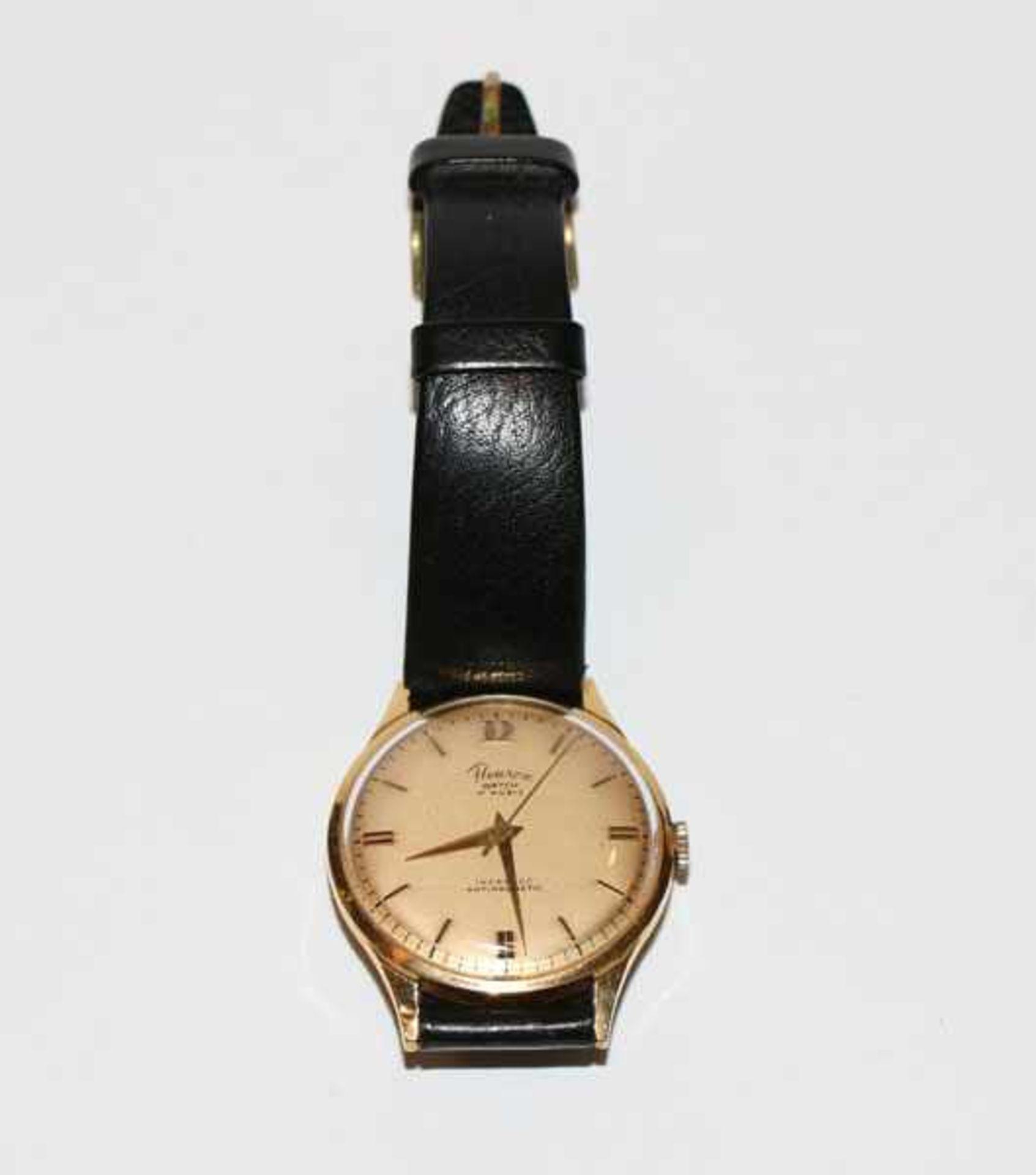 Los 21 - Herren Armbanduhr, Fleuron, Schweiz, 18 k Gelbgold Gehäuse an schwarzem Armband, intakt,