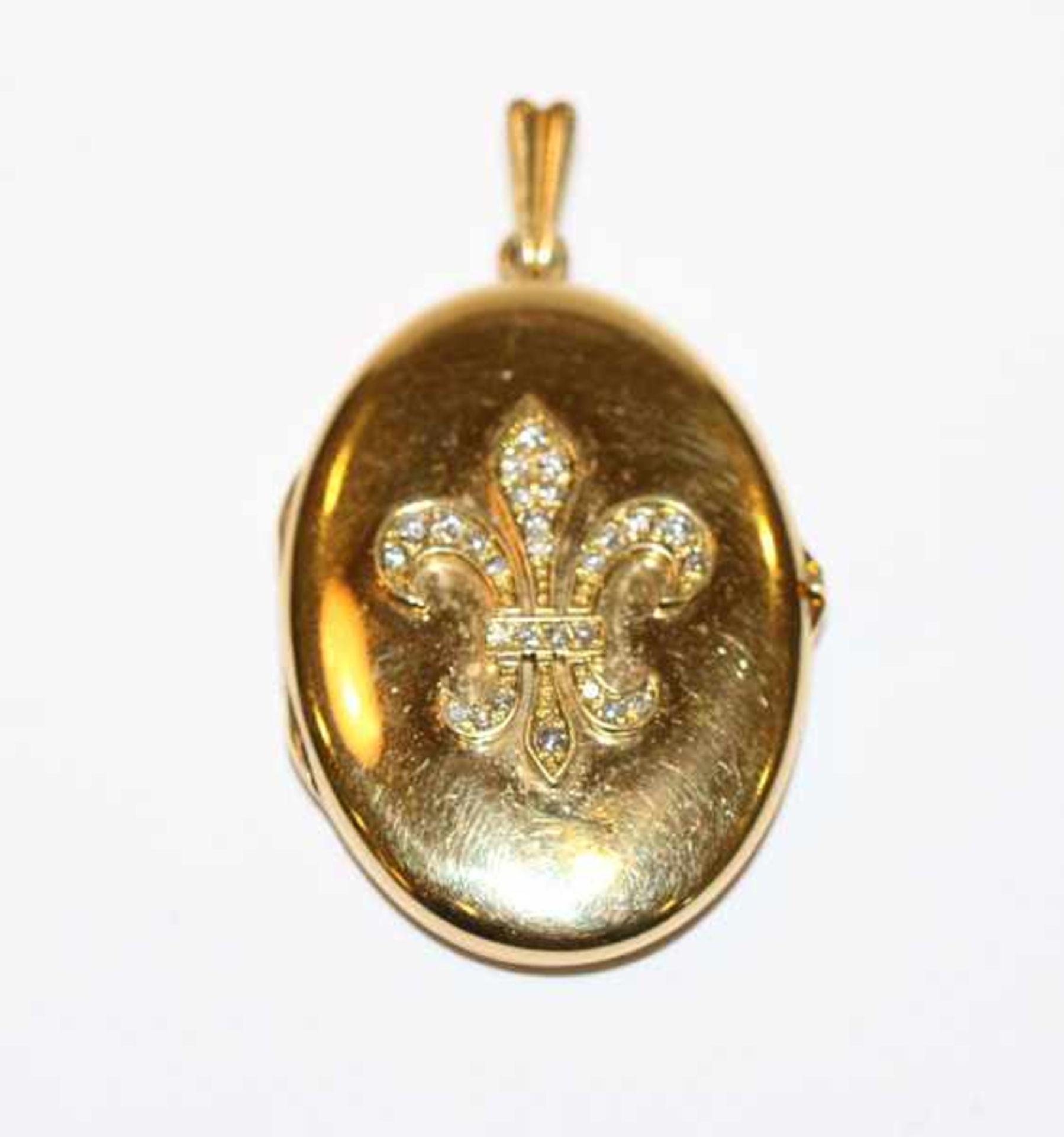 18 k Gelbgold Medaillon-Anhänger in ovaler Form, Vorderseite mit reliefierter Lilie und 28 Diamanten