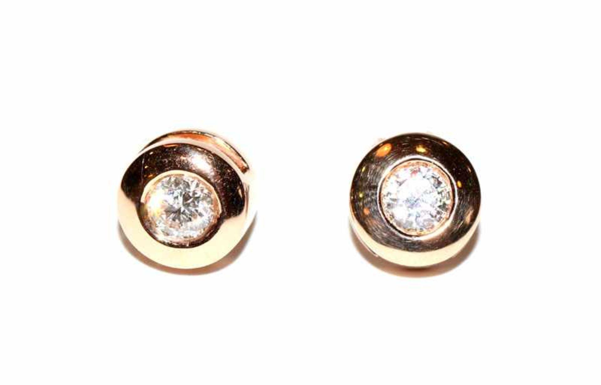 Paar 14 k Roségold Ohrstecker mit zus. ca. 1 ct. Diamanten