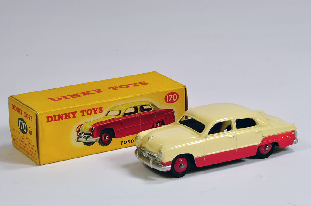 Lot 51 - Dinky No. 170 Ford Fordor Sedan in two-tone cream/red. Bright example is E to NM in E Box.