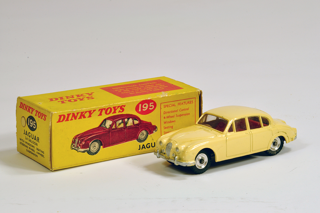 Lot 17 - Dinky No. 195 Jaguar 3.4 Saloon with cream body. NM in E Box.