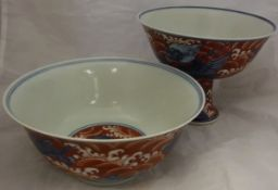 A Chinese terracotta and blue and white decorated bowl with exotic beast decoration and a Chinese