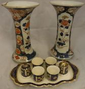 A pair of Imari vases with flared rims and a Royal Winton four place egg cruet