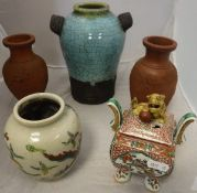 A Chinese turquoise crackle ware ground vase, a pair of Yi Xing dragon decorated vases,