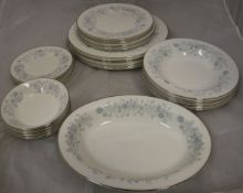 "A collection of Wedgwood ""Belle Fleur"" pattern dinner wares, six place setting,"