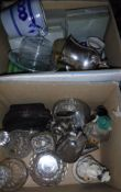Two boxes of china and glass ware to include three decanters, various plated wares, figurines,