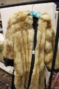 A reversible fox fur jacket with black satin lining
