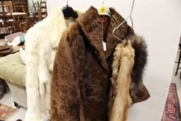 A dyed white rabbit fur jacket together with a further brown fur coat,