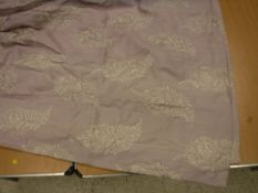 A pair of linen type lilac ground foliate embroidered lined curtains with taped pencil pleat