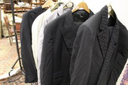 A collection of clothing to include a Versace suit, the trousers size 58,