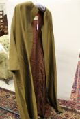 A Worth model olive green corded cotton jacket with brown lining and label inscribed 'Worth Model,