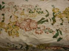 Two pairs of glazed cotton cream ground floral decorated interlined curtains with taped pencil