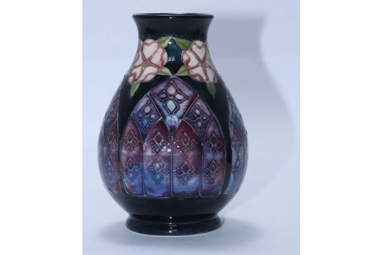 A Small Moorcroft Pottery Vase In The 39gothic Windows39