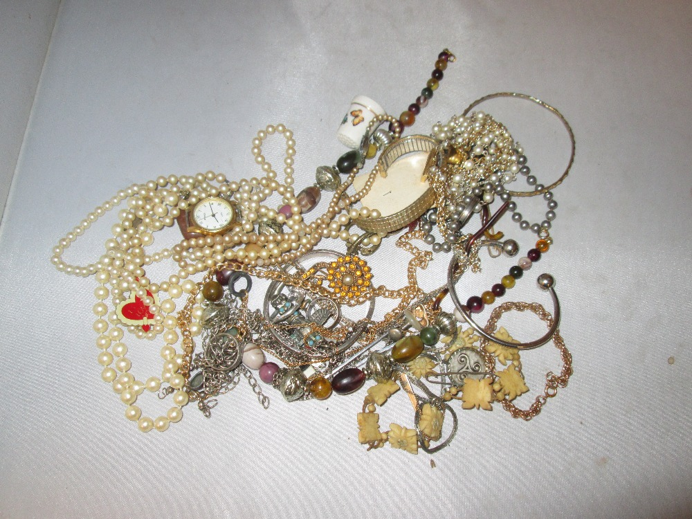 Lot 4 - Bag of assorted costume jewellery, necklaces,, rings, bracelets etc.