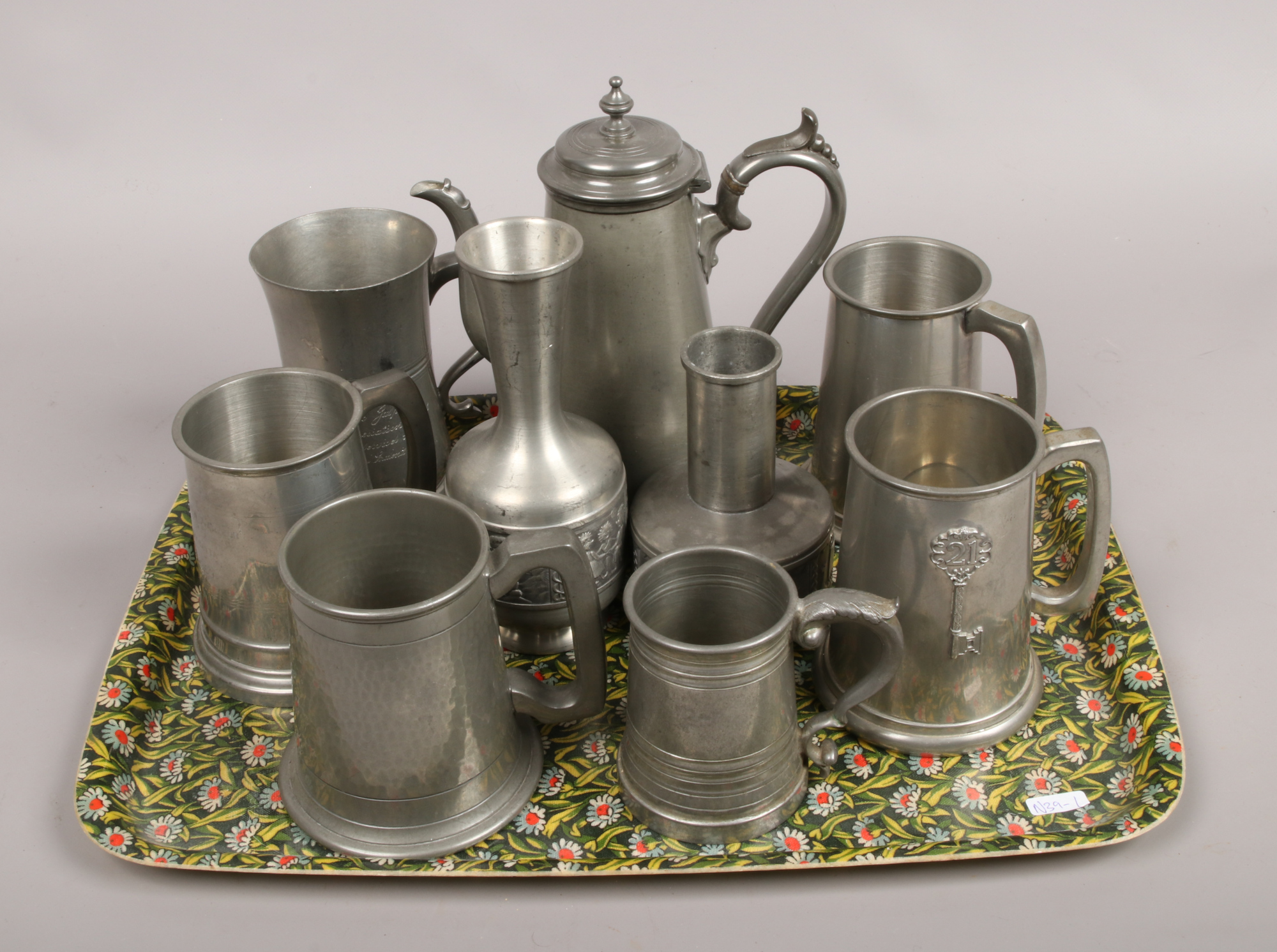 Lot 19 - A tray of pewter items including James Dixon examples.