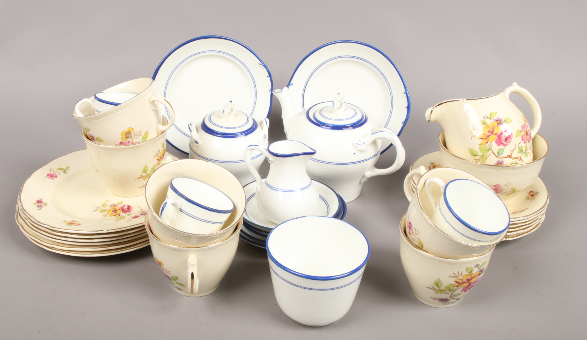 Lot 49 - A six place floral transfer printed tea service stamped England 85 along with a blue and white
