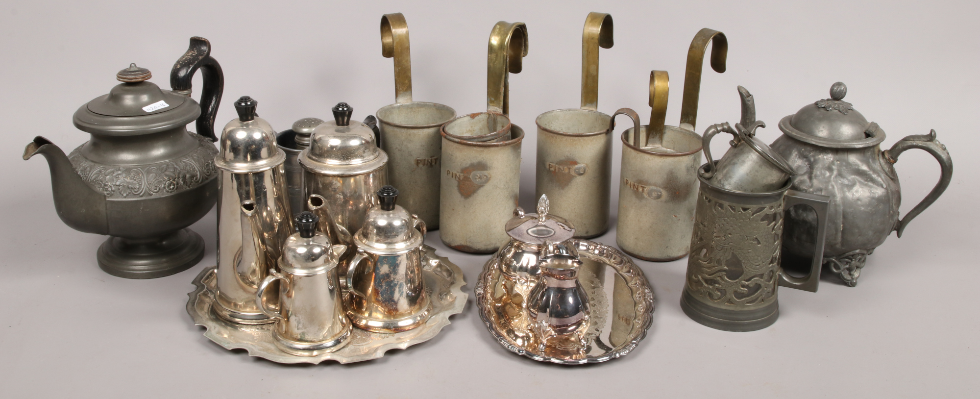 Lot 3 - A collection of metalwares to include Swatow pierced tankard, silver plate tea set, pewter and brass