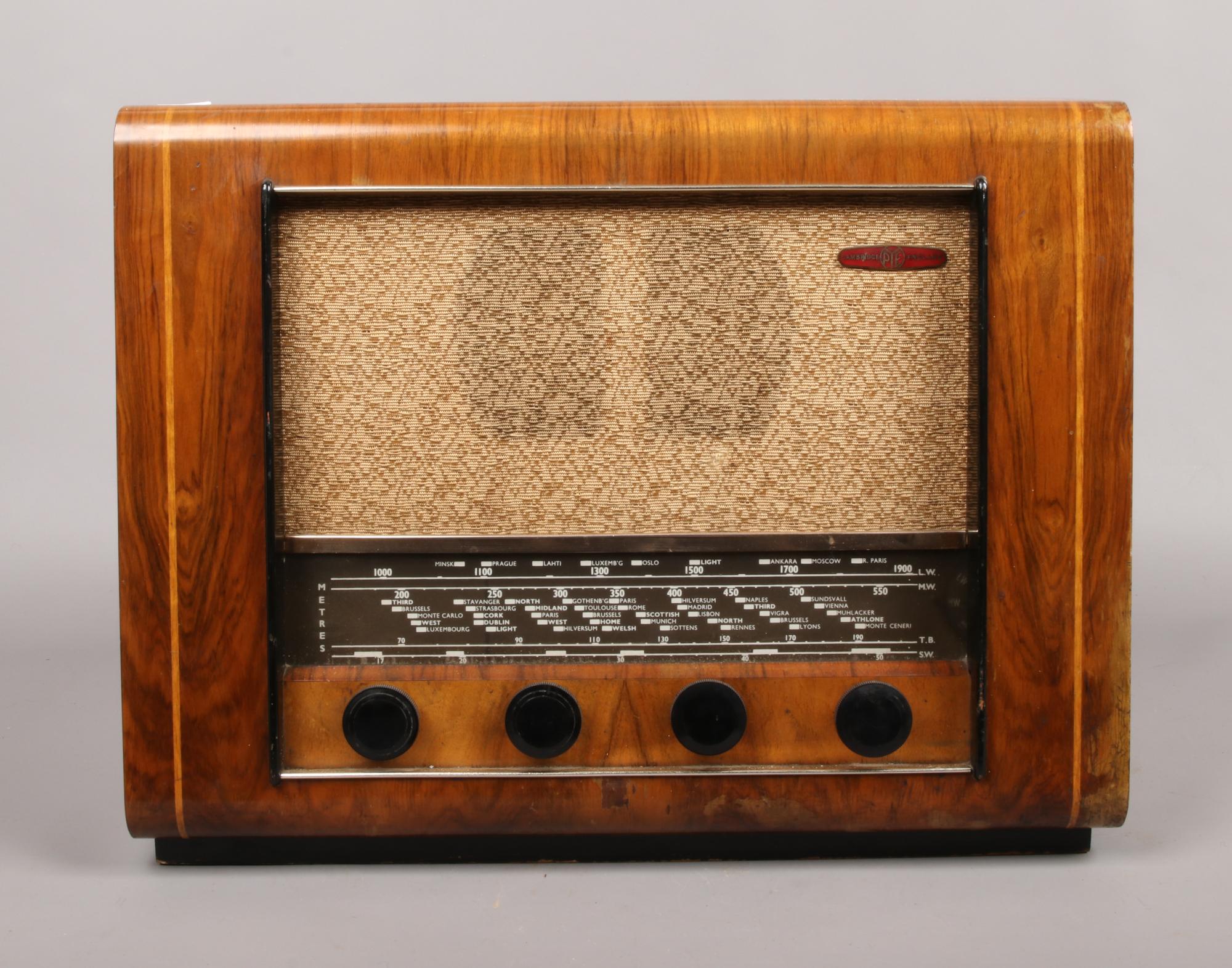 Lot 24 - A vintage Pye radio with wood veneer.