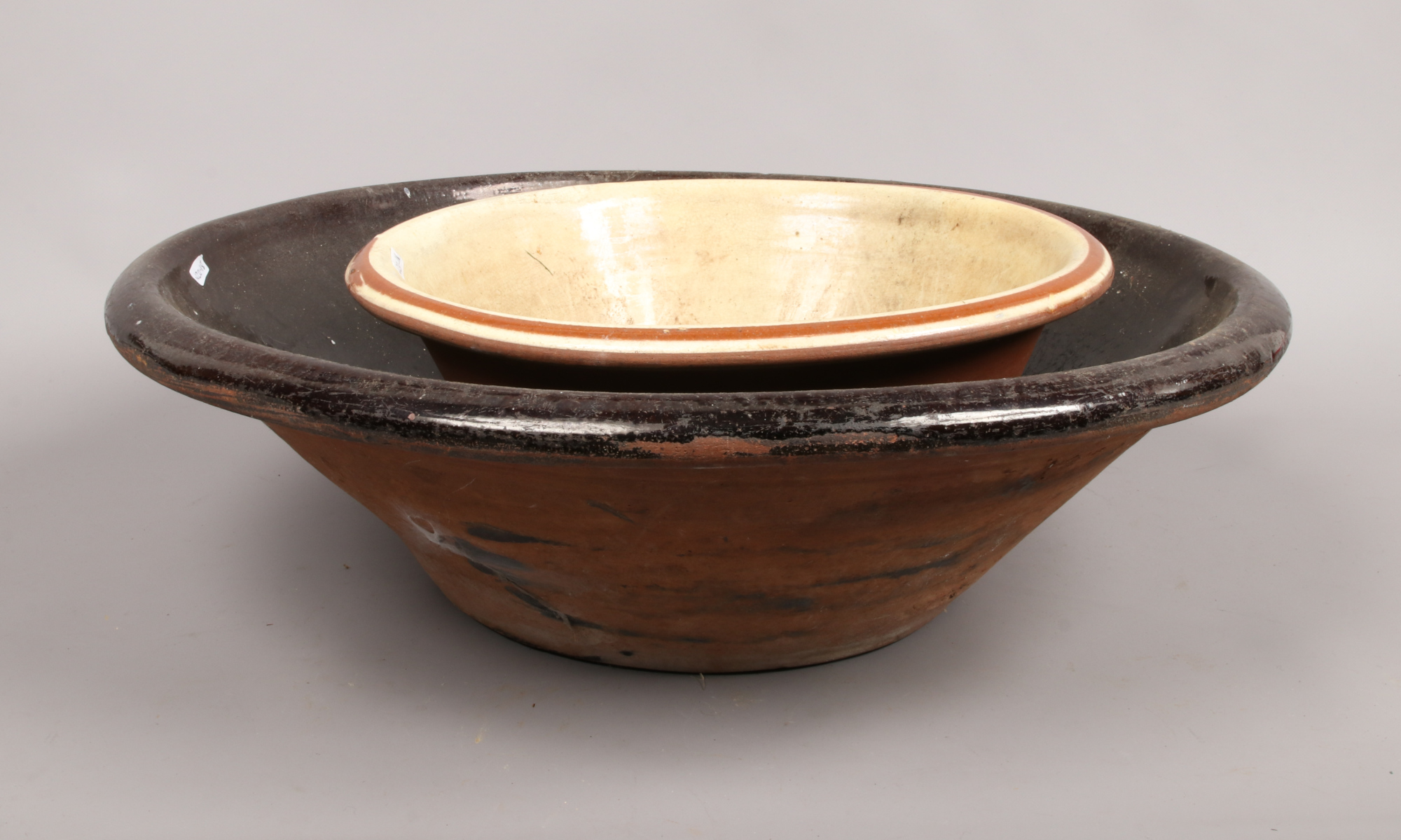 Lot 17 - A large terracotta pancheon along with a smaller example.