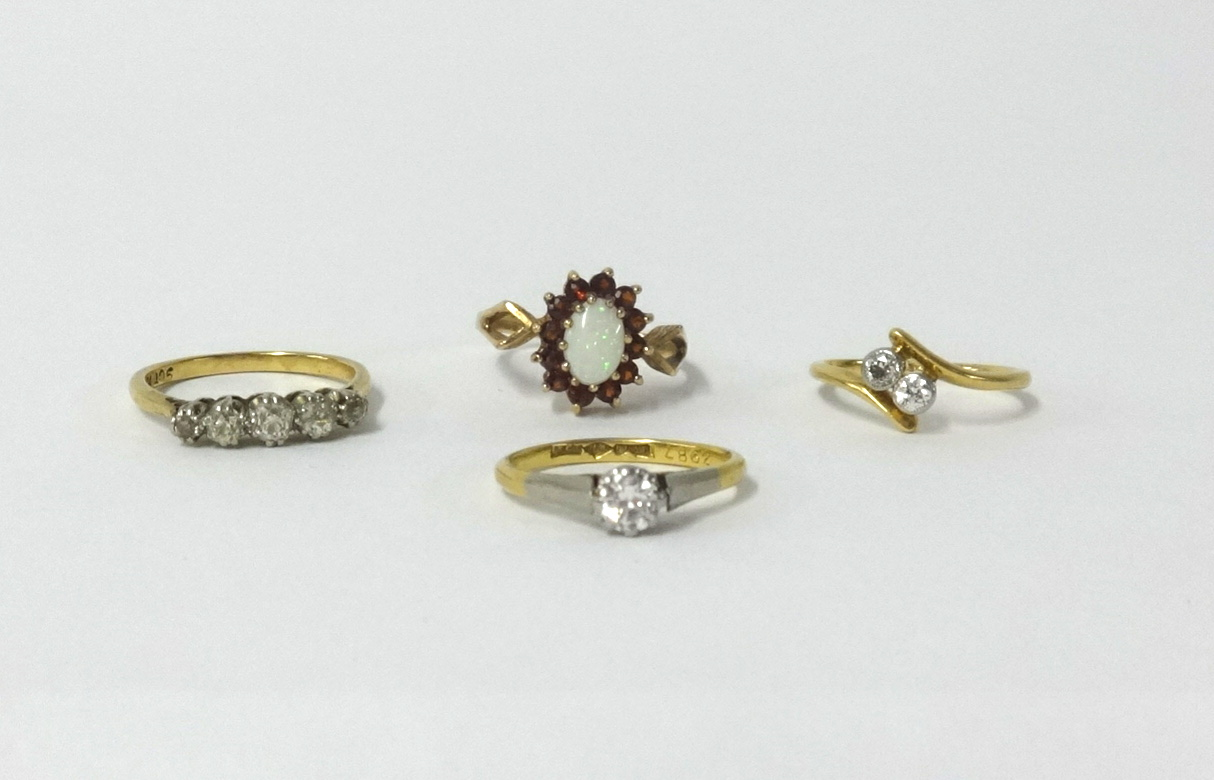 Lot 048 - Four various diamond and opal set dress rings including two 18ct rings, approx 4.10gms and two 9ct