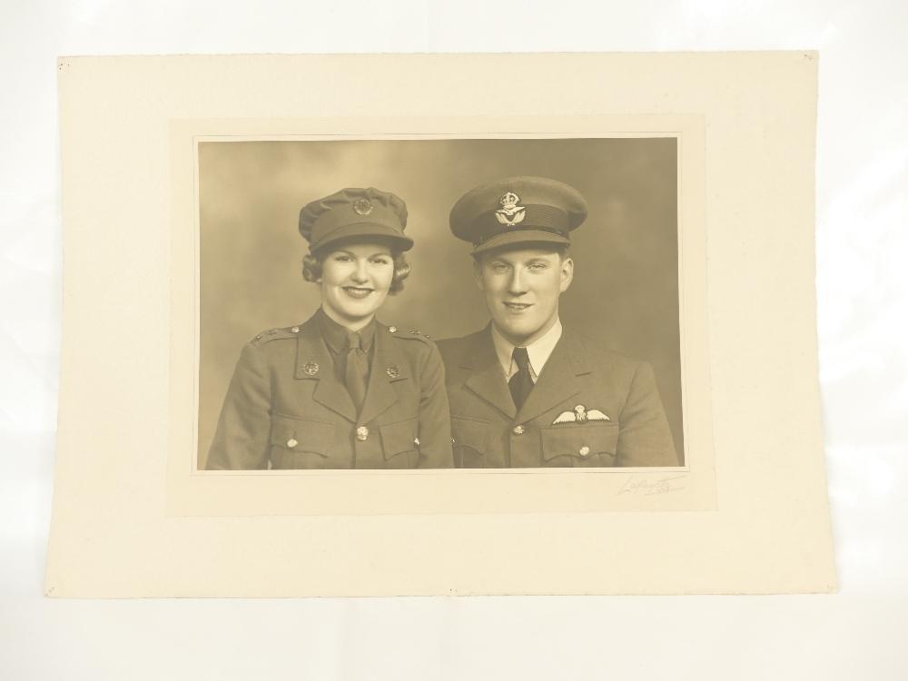 Lot 11 - RAF Flying Officer & Mrs B Heath - large studio portrait bearing full title and description,