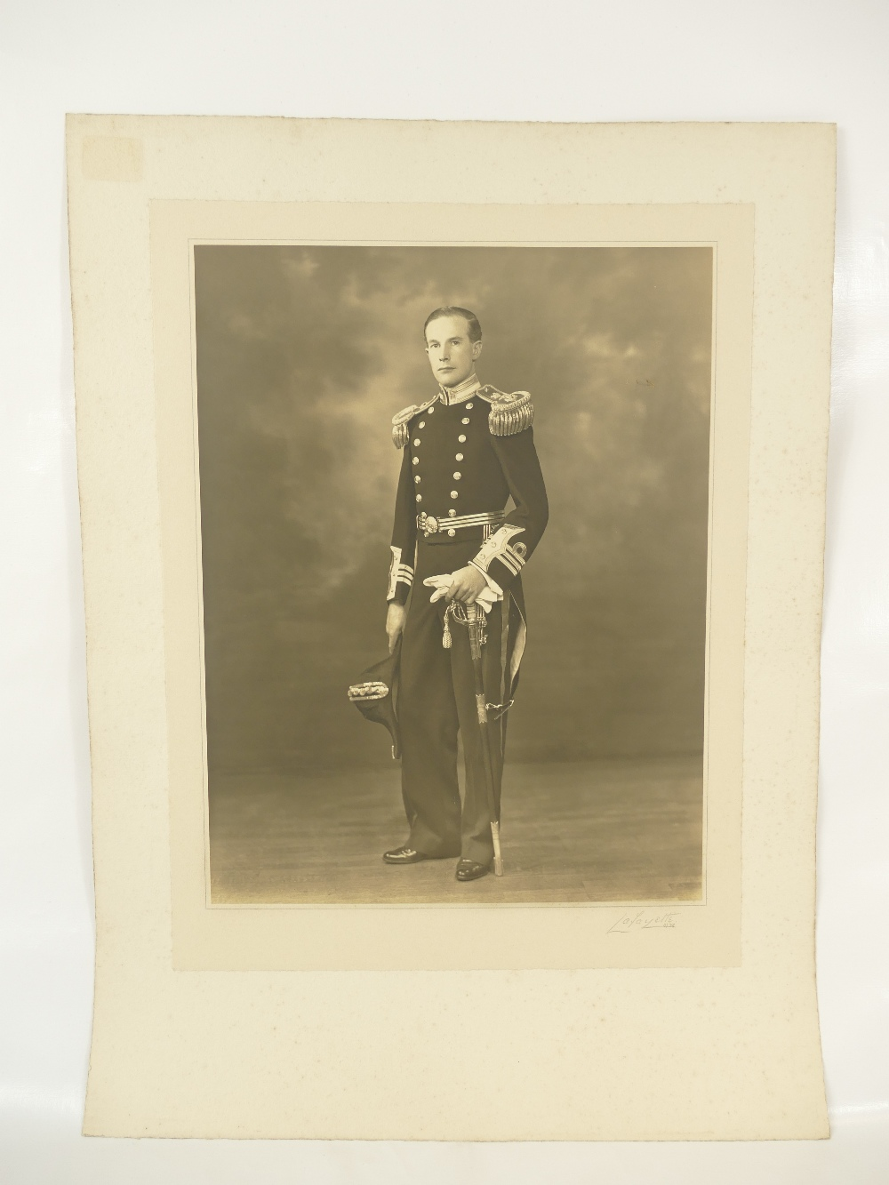 Lot 12 - Commander H P Currey Royal Navy - active during WWII - large studio portrait bearing full title and