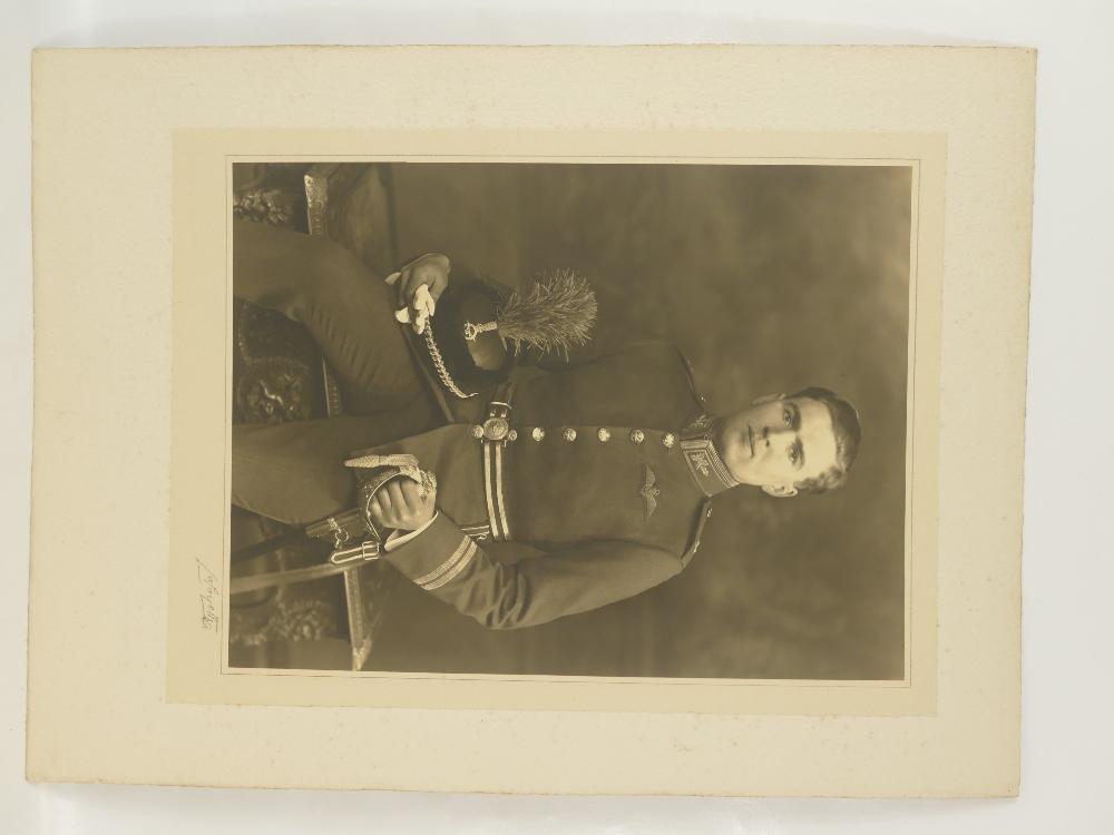 Lot 18 - Flight Lieutenant C R DUNLOP RAF - large studio portrait bearing full title and description,
