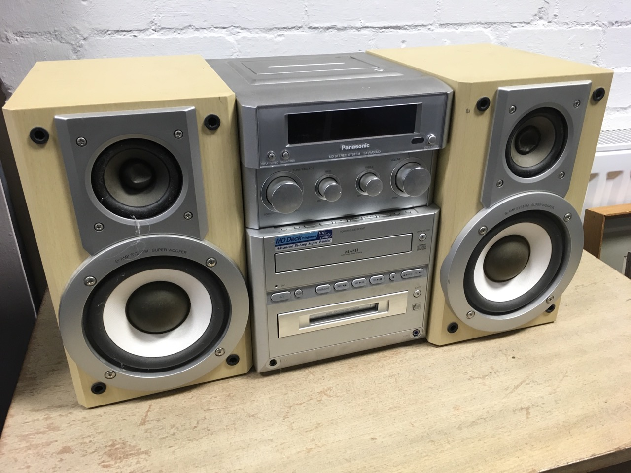A Panasonic MD stereo system, SA-PM30MD, with twin Bi-Amp super ...