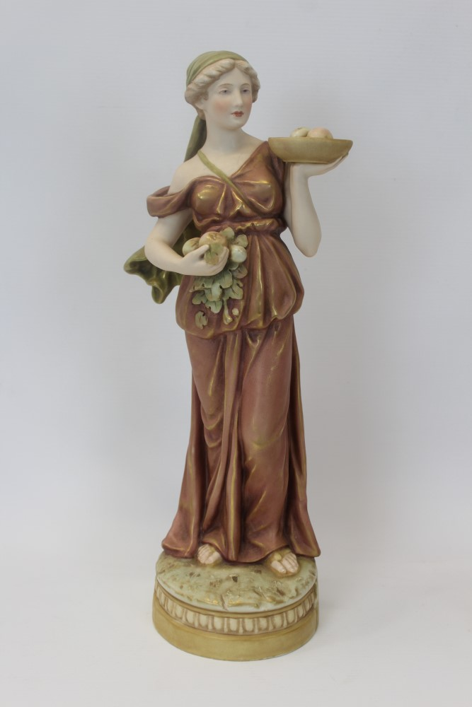 Lot 2056 - Three Royal Dux porcelain figures - lady with bowl of fruit, 38cm high, lady with jug and chalice,