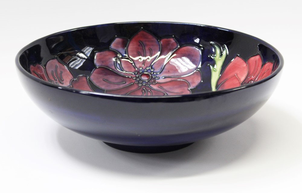 Lot 2005 - Moorcroft pottery bowl decorated in the Poppy pattern on midnight blue ground, impressed marks,