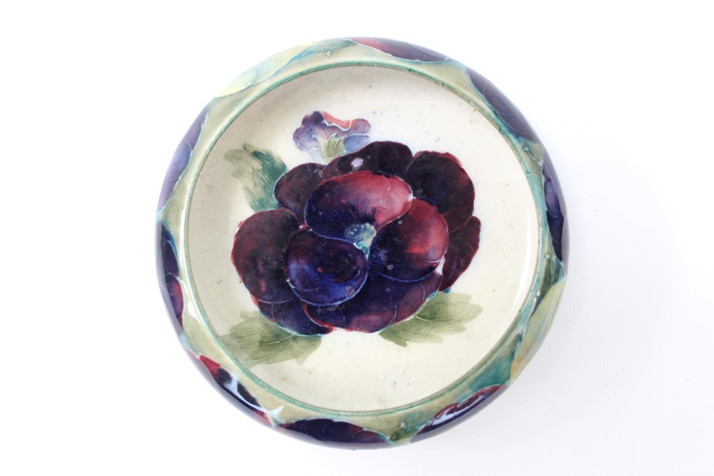 Lot 2004 - Moorcroft pottery circular dish decorated in the Pansy pattern,