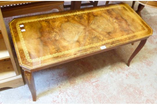 A Reproduction Soro Coffee Table With Book Matched Walnut Effect Top Set On Cabriole Legs