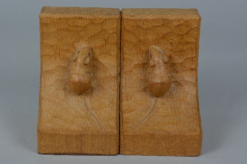 A PAIR OF ROBERT THOMPSON 'MOUSEMAN' OF KILBURN OAK BOOKENDS, each carved with a mouse to the