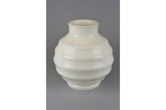 A Keith Murray Wedgwood Football Vase In A Cream Glaze Printed
