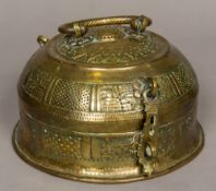 An Indian brass spice box and cover With swing handle and hinged cover, the body pierced. 21.