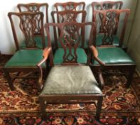 A set of six 19th century mahogany dining chairs Each with scrolling top rail above the pierced