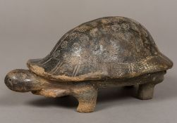A South American antiquity model of a tortoise Typically modelled, standing on all fours.