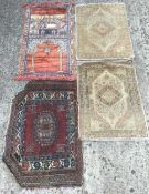 Four miniature rug samples Comprising: two of Persian design,