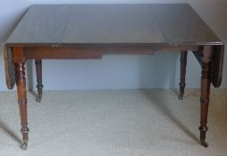 An early 19th century mahogany drop-flap extending dining table The hinged rounded rectangular top