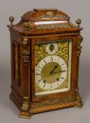 A 19th century German Lenzkirch mantel clock The figured walnut case with gilt mount finials and