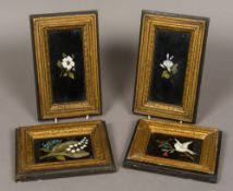 Four pietre dura plaques Each framed and depicting a flower, one also with a dove.
