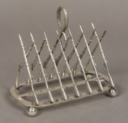 A late 19th century Victorian silver plated toastrack Worked as fourteen crossed military rifles,