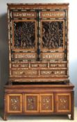 A 19th century Chinese ivory inlaid and carved side cabinet The top section profusely inlaid with